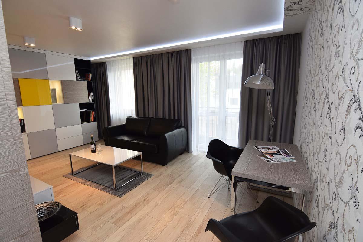 Wizualizacja salonu w mieszkaniu pokazowym wykonana przez naszych projektantów wnętrz
